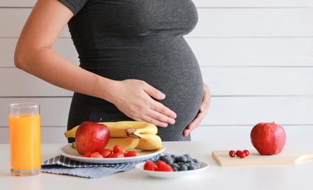 Pregnant woman drink orange fruit juice, healthy