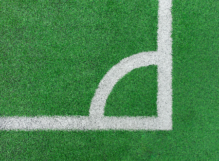 Green sport football field with white marker line, texture