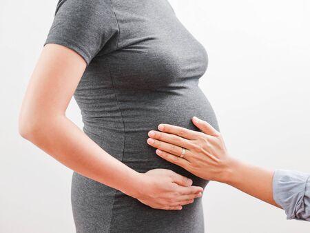 Pregnant woman wife and husband hug with love 版權商用圖片