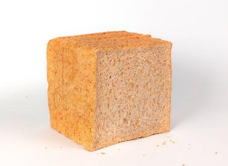 Loaf of sliced whole wheat bread, healthy organic breakfast food