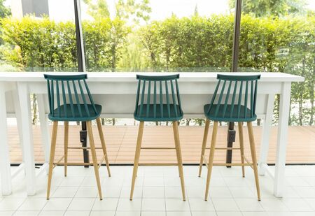 White table and wooden chairs with nature daylight window view 版權商用圖片