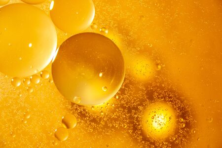 Golden yellow bubble oil droplet, abstract