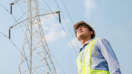 electrical engineer stand and work at electric power pole