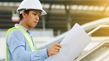 engineer hold blueprint draft paper at construction site Standard-Bild