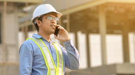 Engineer talk on mobile phone at construction site