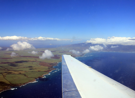 wing view plane flying above maui