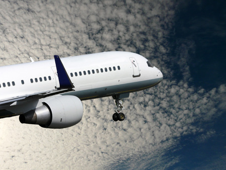 white plane takes off against nice sky
