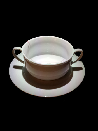 white cup in darkness