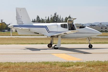 strange small white plane