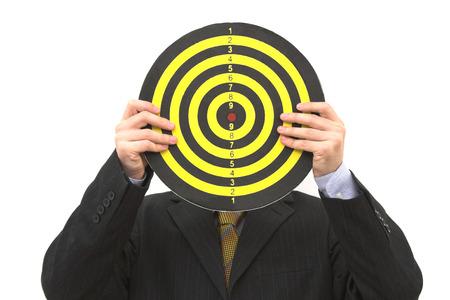 image of a businessman holding a dartboard