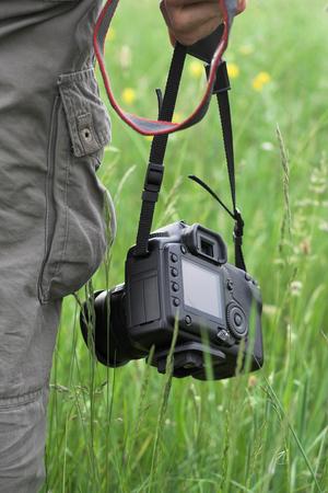 photographer holding a digital SLR camera