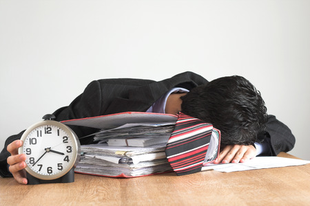 tiring:  exhausted businessman working hard Stock Photo