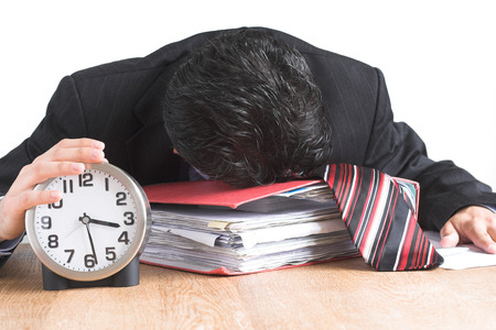 image of an exhausted busienssman trying to get the job done before the deadline