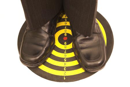 successfulness: businessman standing on dartboard