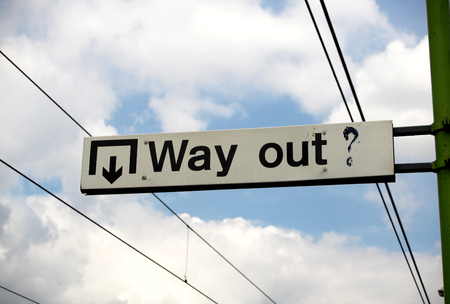 way out: street sign the word way out written on it
