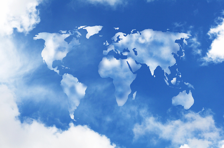 traveler: world map shaped clouds in the sky  Stock Photo