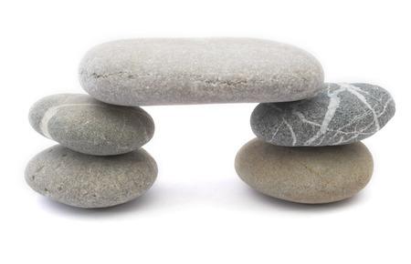 some pebbles balanced to reprecent the concept bridging