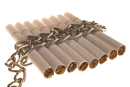 cigarattes lined up and tied with a chain photo