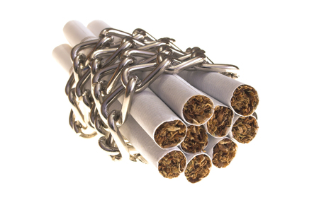 cigarettes tied with chain over white s�rface photo