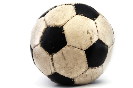 a used football placed over white