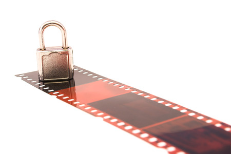 censor: film and padlock captured over white