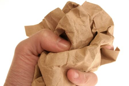 throw up: image of a hand squizing crumpled paper
