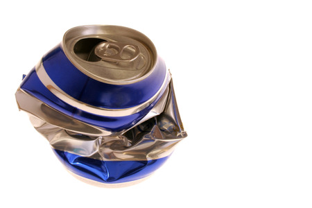 image of a crushed beer can on white surface Stock Photo