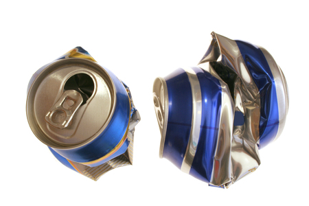 two crushed beer cans captured over white