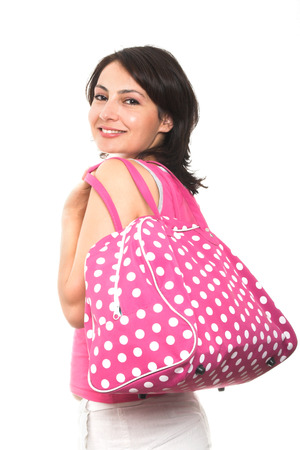 young attractive woman holding a pink hand bag