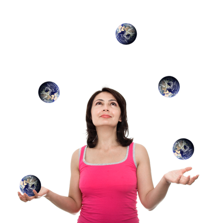 a courtesy: young attractive juggler plying with earth (earth image courtesy of NASA-visible earth-)