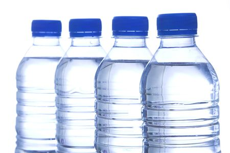 four bottled water in line
