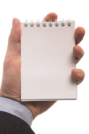 businessman holding a notepad in hand Stock Photo - 2235594