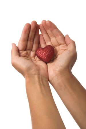 image of a heart shaped figure held in hands