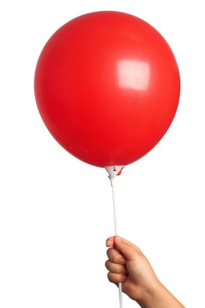 kid holding a red balloon in hand photo