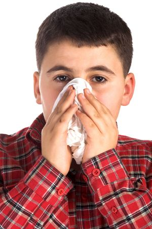 portrait of a  boy blowing his nose