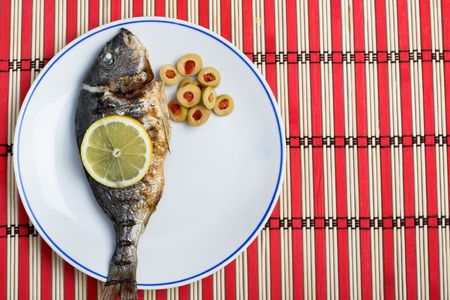 grilled gilt-head bream served with vegetables  photo