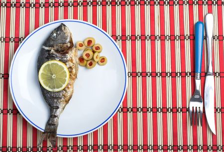 grilled fish served with vegetables photo
