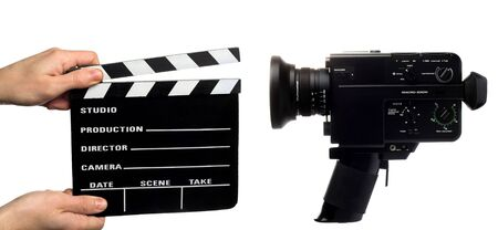 shutting: hands holding a movie clapper  and a vintage movie camera