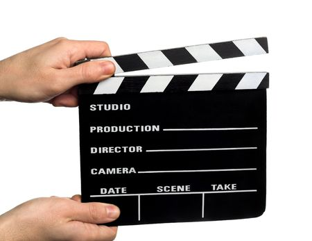 slate board: hands holding a movie clapper