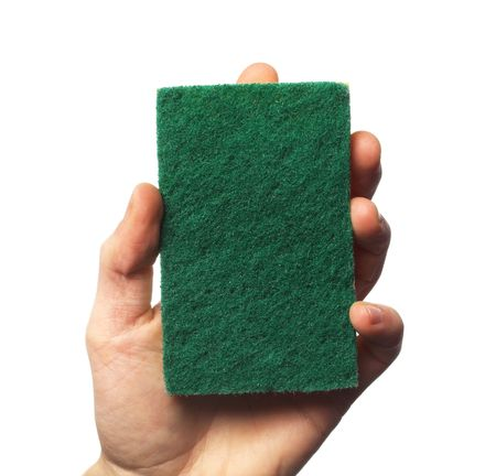 scrubbing up: holding a cleaning sponge in hand Stock Photo