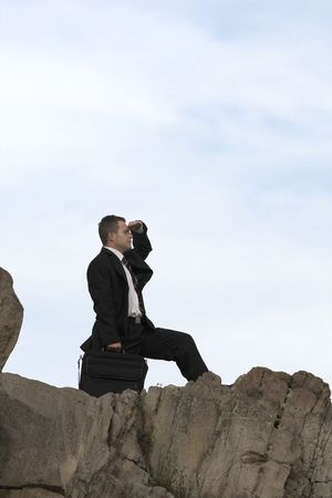 foresee: businessman on the peak looking through new horizons Stock Photo