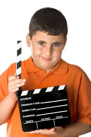 young boy holding a vintage movie clapper board