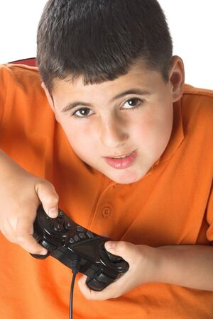 young boy playing computer games photo