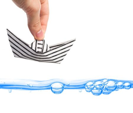 commence: stripey paper boat in hand Stock Photo
