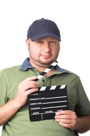 man holding a movie clapper board in hand photo