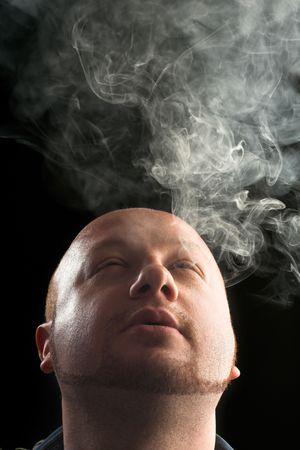 portrait of a man smoking in the dark photo