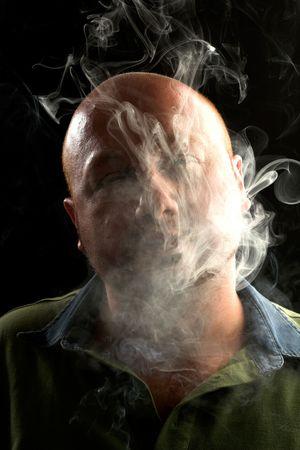 lonliness: man smoking in the dark  Stock Photo