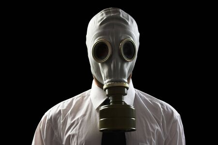 gas mask: businessman wearing gas mask