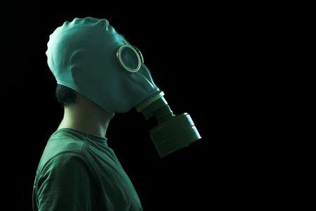 fetish wear: man wearing a gas mask side view