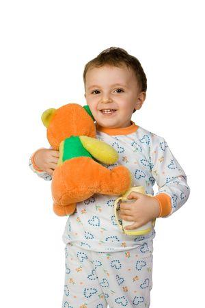 boy cuddling a teddy bear and holding a milk botttle Stock Photo